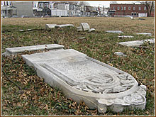 toppled grave stone two